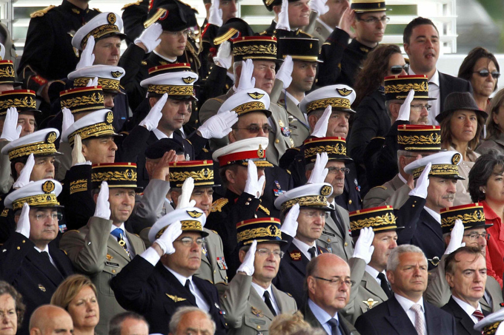 High ranking officers of French army salute during the traditional Bastille Day military parade in Paris
